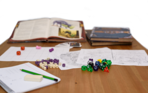 books, character sheets, and dice