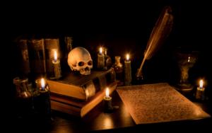 books, parchment, pen, ink, skull